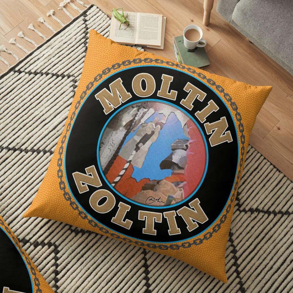 Moltin Zoltin on a yellow pillow